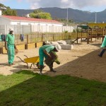 Laying grass in the new improved playground